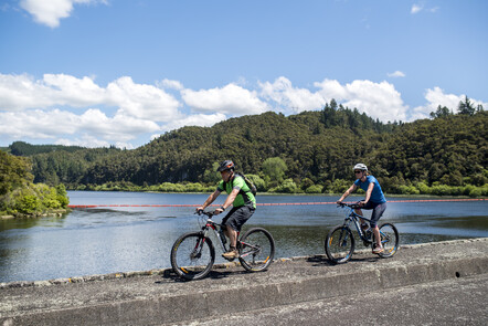 Waipapa Dam - Riding across Waipapa Dam with Lake Waipapa in the background.
